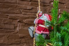 Christmas composition of a Christmas tree and Santa Claus climbing a rope stock photography