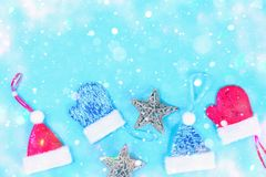 Christmas composition from Christmas tree toys. White decor on a blue background. Copy space, flat lay, top view. Christmas composition from Christmas tree toys Royalty Free Stock Images