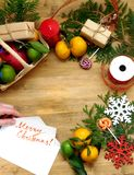 Christmas composition consisting of citrus, sweets, thuja branches and present boxes stock image