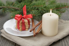 Christmas composition with cookies and candle Royalty Free Stock Photos