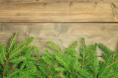 Christmas composition with copy space. Spruce branches neatly laid out bottom of the photo. Festive layout. royalty free stock images