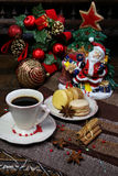 Christmas composition: a cup of black coffee and sweet macaroons Royalty Free Stock Photography