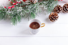 Christmas composition. Cup of coffee, larch branches, anise star Royalty Free Stock Photo