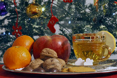 Christmas Composition with a Cup of Tea. Fruit and in background with Christmas tree Stock Photo