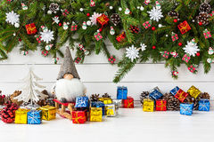 Christmas composition with decorated Christmas fir tree, gnome, gift boxes Royalty Free Stock Photos