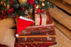 Christmas composition decorative tree with gifts boxes toys. Christmas composition decorative tree vintage suitcase with gifts boxes toys fective background Stock Photo