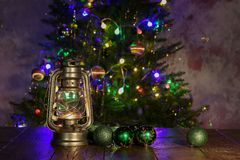 Christmas composition with dressed Christmas tree in the background.  royalty free stock image