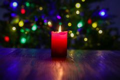 Christmas composition with dressed Christmas tree in the background.  royalty free stock photo