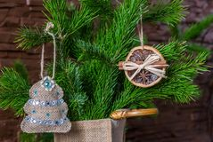 Christmas composition of dry orange slices and cinnamon sticks and a Christmas tree on a branch royalty free stock photos