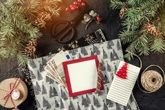 Christmas composition with empty note, money euro, xmas wrapping, fir branches, gifts, pencil on holiday background. Xmas and Happy New Year theme. Flat lay royalty free stock photos