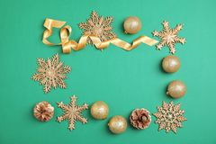 Christmas composition with festive decor on color background. Flat lay Christmas composition with festive decor on color background Royalty Free Stock Images