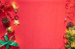 Christmas composition festive. Christmas decorations, red and gold ornaments on red background. Celebration for Christmas, New Yea