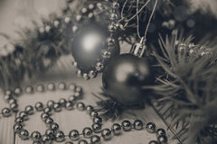 Christmas composition with fir banch, bead and balls.New Year royalty free stock images