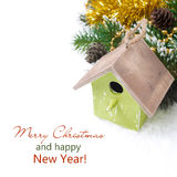Christmas composition with fir branches, decorations, birdhouse Royalty Free Stock Images