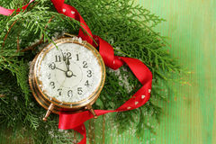 Christmas composition with fir branches, decorations and clock Royalty Free Stock Photos