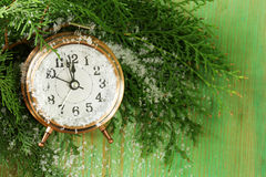 Christmas composition with fir branches, decorations and clock Stock Photos
