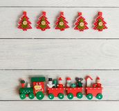Christmas composition with fir tree clothespin, train. Top view, flat lay. Royalty Free Stock Photo