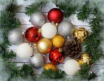 Christmas composition with fir tree, cones and balls. White wood plank background. Christmas composition with fir tree, cones and balls Royalty Free Stock Photos