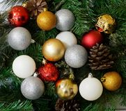 Christmas composition with fir tree, cones and balls. White wood plank background. Christmas composition with fir tree, cones and balls Stock Image