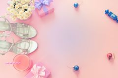 Christmas composition flat lay beauty fashion women`s accessories shoes silver box gift bow party cocktail flowers toys on Christ. Mas tree. Top view copy space stock photos