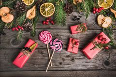 Christmas composition on a wooden table. Christmas composition of flowers, gifts, dried fruits on a wooden table. Christmas background. top view Stock Photos