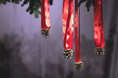 Christmas composition with strobiles on red tapes stock photography