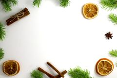 Christmas composition. Christmas frame of fir branches cinnamon, orange and anise. Christmas Wallpaper. Flat position. Top view Stock Photo