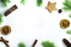 Christmas composition. Christmas frame of fir branches, cinnamon, orange and star anise. Christmas Wallpaper. Flat. Christmas composition. Christmas frame of fir Royalty Free Stock Image