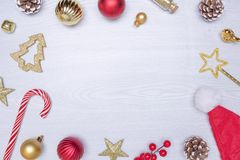 Christmas composition. Frame made of christmas gifts, , toys on white wooden background. Flat lay, top view, copy space. Stock Image