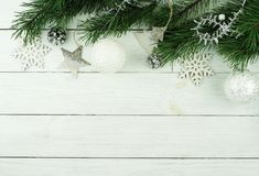 Christmas composition frame made of pine branches and new Year decoration on white wooden background Royalty Free Stock Photo