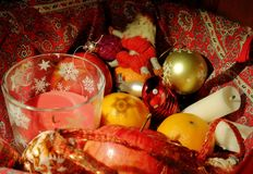 Christmas composition with fruit, candles and Christmas decor royalty free stock photography