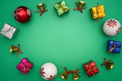 Christmas composition. Christmas gift, bell and ball on green background. Flat lay, top view, copy space royalty free stock photos