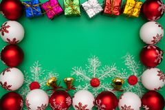 Christmas composition. Christmas gift, bell and ball on green background. Flat lay, top view, copy space royalty free stock photo