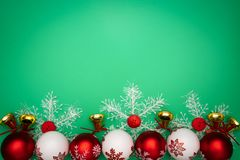 Christmas composition. Christmas gift, bell and ball on green background. Flat lay, top view, copy space royalty free stock photography