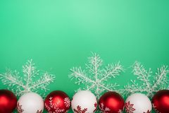 Christmas composition. Christmas gift, bell and ball on green background. Flat lay, top view, copy space stock photo