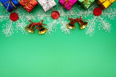 Christmas composition. Christmas gift, bell and ball on green background. Flat lay, top view, copy space stock images