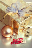 Christmas composition with gift box and bauble Stock Photo