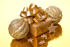 Christmas composition with gift box and baubles Royalty Free Stock Photos