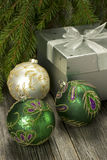 Christmas composition   with gift box and christmas baubles Royalty Free Stock Images