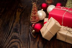 Christmas composition with gift box and decorations on old woode Stock Photos