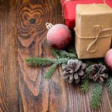 Christmas composition with gift box and decorations on old woode Royalty Free Stock Photos
