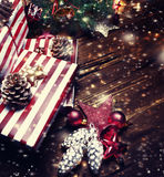 Christmas composition with gift box, fir tree and christmas deco Stock Photography