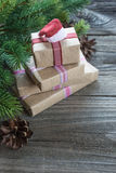 Christmas composition with gift boxes and Santa`s cap Royalty Free Stock Photography