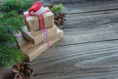 Christmas composition with gift boxes and Santa`s cap Stock Image