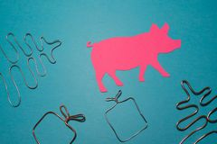 Christmas composition. Christmas gift, Christmas tree and pig on blue background royalty free stock photo