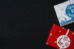Christmas composition. Christmas gifts boxes on black shine background. Flat lay, top view, copy space royalty free stock image