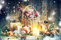 Christmas Composition Gifts Burning Candle Basket Royalty Free Stock Photography