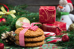 Christmas Composition.  Ginger cookies on wooden background. Stock Photos
