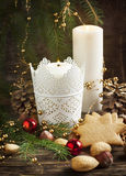Christmas composition with gingerbread and candles Stock Photo