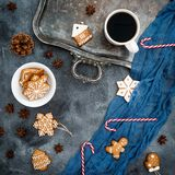 Christmas composition. Gingerbread, candy cane and coffee cup on dark background. New year concept Royalty Free Stock Image